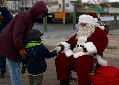 It's nice to meet you Santa: Johann shakes hands with Santa